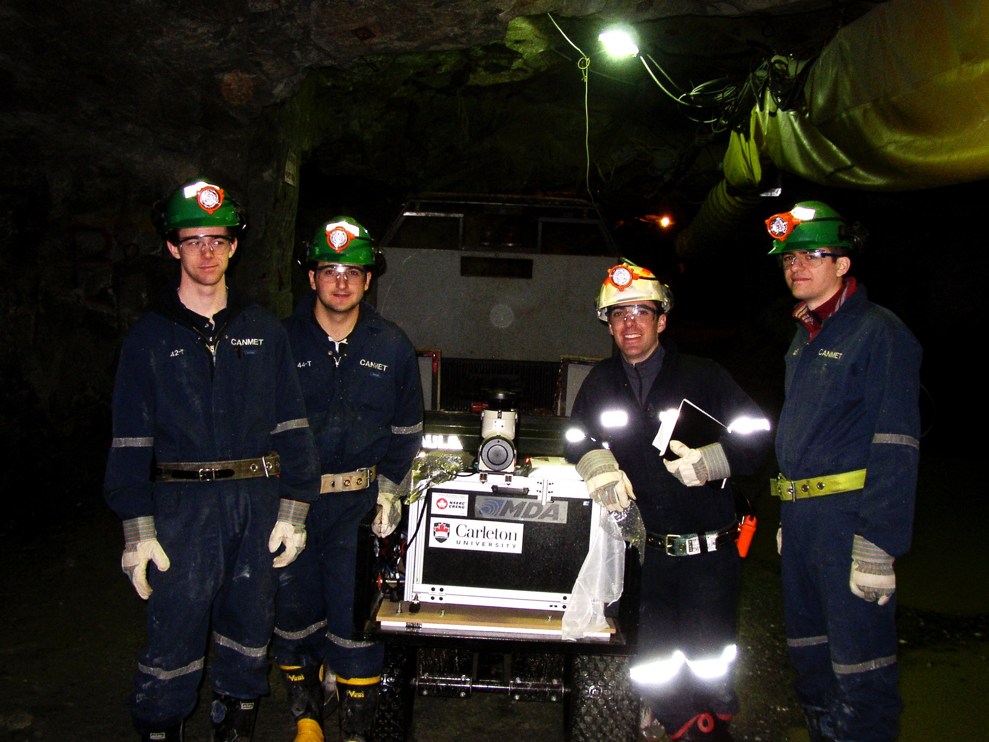uGPS research team underground with an early uGPS prototype at the CANMET Experimental Mine near Val d'Or, QC