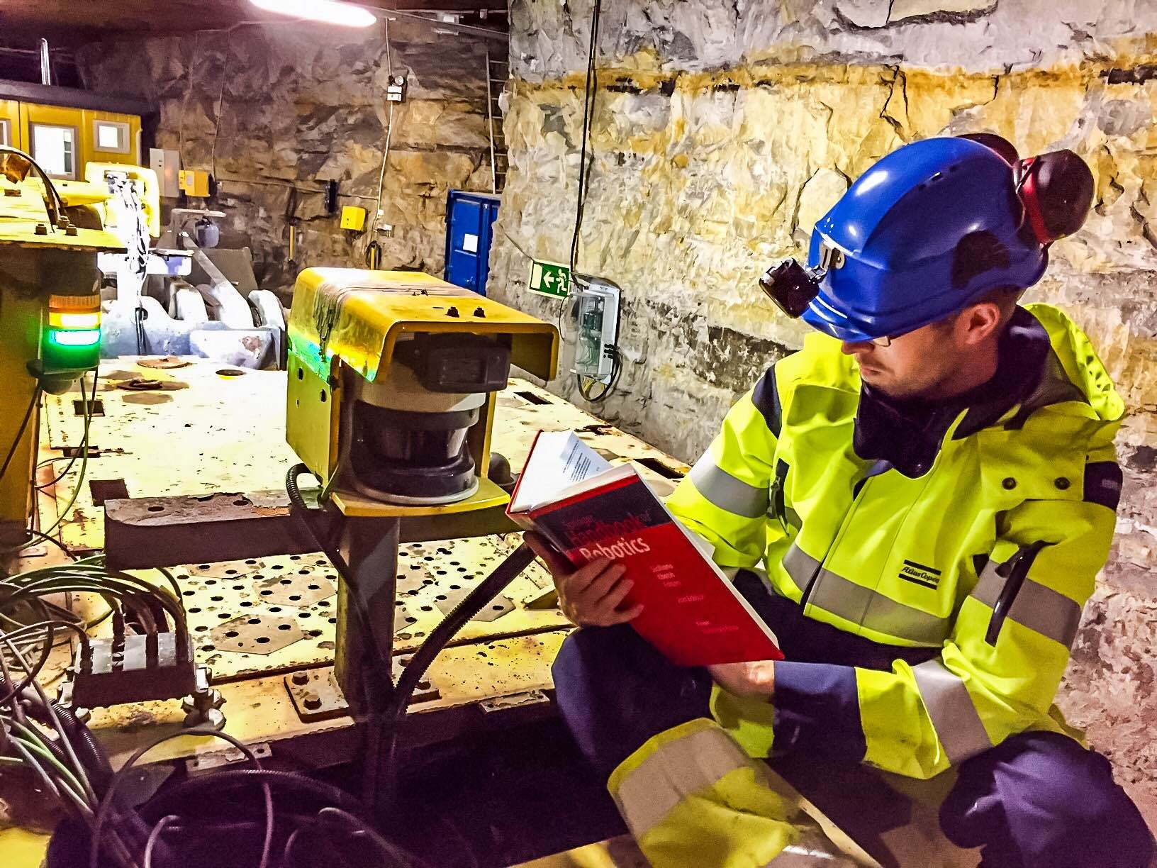This photo of the Handbook of Robotics was taken underground at the Atlas Copco test facility near Kvarntorp on a robotic ST14 LHD machine.